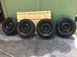 Selling a set of 4 tires and rims Goodyear Nordic