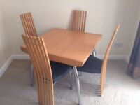 Modern Hardwood Extendable Dining Table And Four Chairs
