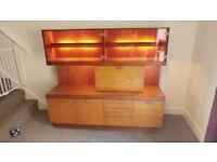 Teak color lounge/dining room Wall unit / dresser. good condition, internal lighting.