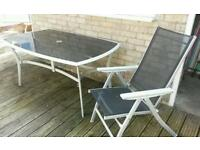 Glass garden table with 4 reclining chairs