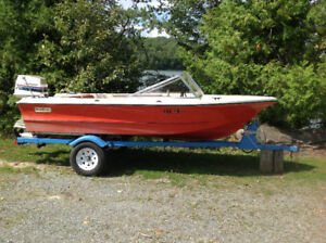 Older Model Surf Master with 70hp Evinrude and Trailer