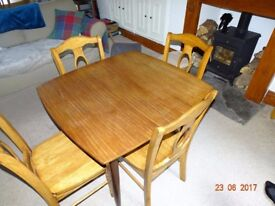 Extendable Dining Table and Four Chairs For Sale