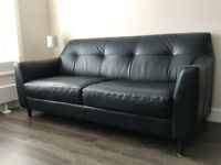 Leather sofa - contemporary style and nearly new