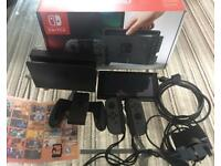 Nintendo Switch with Zelda and 1-2 switch game, in perfect condition
