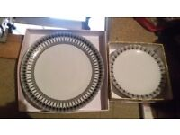 Dinner plates and side plates.