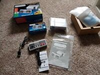 As new, NES Classic Mini with second genuine NES controller
