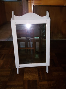 Vintage wooden wall-mount Medicine Cabinet with mirror front.