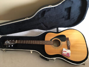 Selling an Acoustic Guitar with case - Yamaha F310
