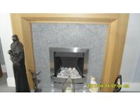 Wood finish fire surround, chrome finish gas fire, hearth and back.