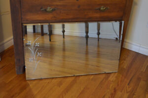 Lovely vintage style wall mirror with etched design.