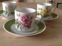 Three German cups and saucers
