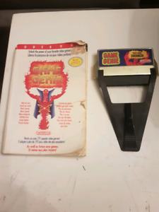 Nes game genie with booklet