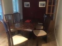 Dining table and chairs cost £1800 willing to negotiate on price due to damage on chair, ..year old