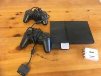 PS2 with games and controllers