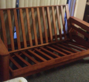 Wooden futon with hidden conpartments