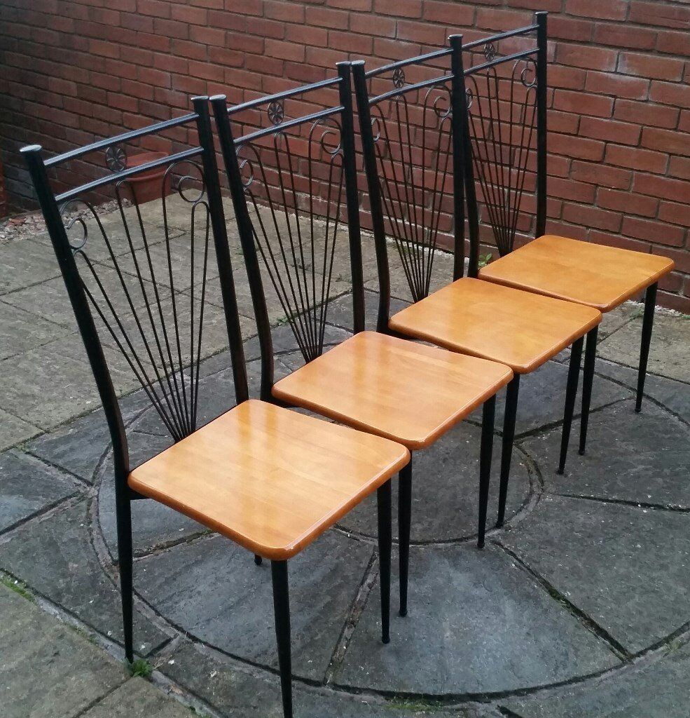 4 dining chairs. In excellent condition. black metal frame, wooden seat. see photos for more detail.