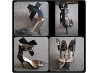 Size 7/40 lace and bow heels brand new, never been worn, too high.