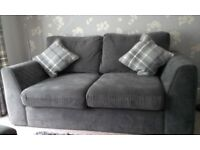 large grey two seater sofa
