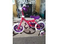 "Sweetie Kids' Bike - 12"" as new. Suitable for 3-5 year old. Also Minnie Mouse Safety Helmet as new."