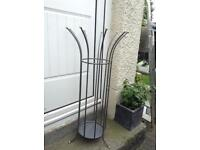 Umbrella/hat stand this is ideal for keeping your cupboard tidy £10.