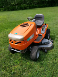 Riding lawn mower with snow blower attachment