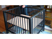 Black wooden playpen with three different levels 80cm x 89cm . Very good condition.