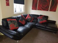 Black Leather Corner Suite excellent condition no rips complete with red cushions