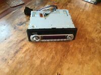 Car stereo kenwood with CD player. Plug and play. Good condition