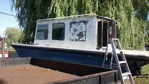 Solid work boat with dual axel trailer