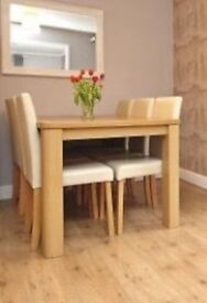 Dining table and 6 cream leather chairs
