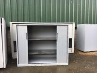 Metal shelved storage cabinets
