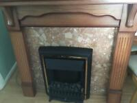 Electric fire with wood surround & marble effect background