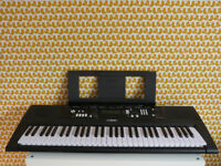 Yamaha EZ220 electric keyboard with 61 Lighted/Touch-Sensitive Keys (play along)