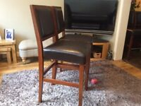 Real wood and leather bar stool height chairs.