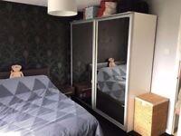 Double IKEA PAX wardrobe with sliding mirrored doors and interior ( 3x rails and 1x shoe rack)