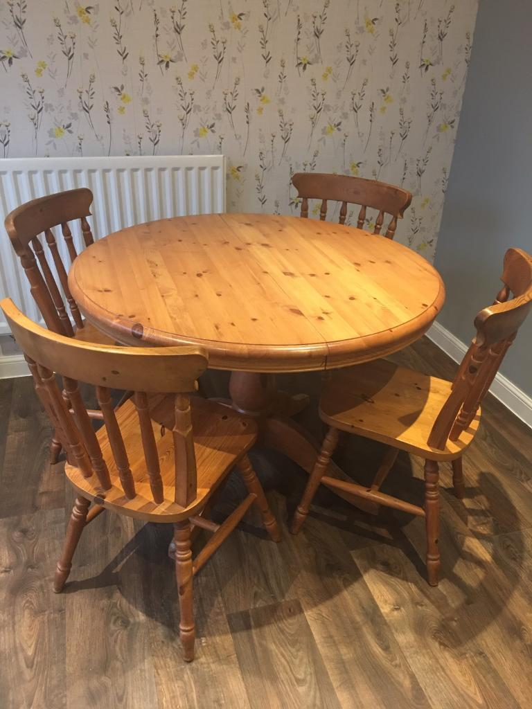 Pine extendable round table and 4 chairs by St Michaels furniture