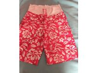 4 pairs board shorts size 8 and 10