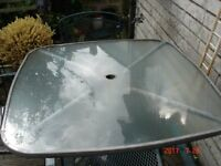 Glass Square Garden Table with Metal Legs and 6 Metal Chairs with Arms which are stackable