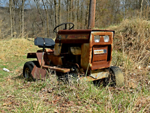 Old lawn or garden tractors and equipment