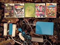 Wii console with 3 controllers and 5 games