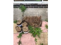 8 rolls of brown bamboo garden/ plant boarders