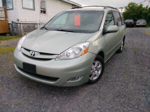 2009 Toyota Sienna LE leather low kms 120k only. 1year warranty