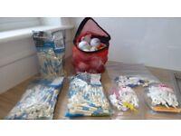 selection of dunlop golf balls, tees and golf bag rain cover