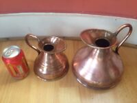 Two copper jugs with lead seals.