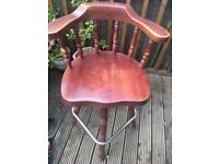 Solid mahogany swivel bar chairs with footrest.