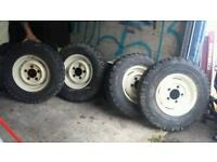 Four Land Rover rims with tyres