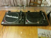 Technics 1210 mk2s, classic decks. Pair, with lids, Technics headshells, slipmats and Stanton 500s