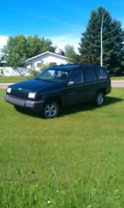 97 Jeep Grand Cherokee *needs motor rebuilt or swapped!*