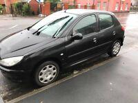 Black Peugeot 206 - Cardiff City Centre
