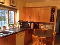 Oak kitchen with wine racks, work tops, sink, taps and stalls